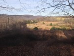 Hilltop Lodge Atop Motocross Track in January